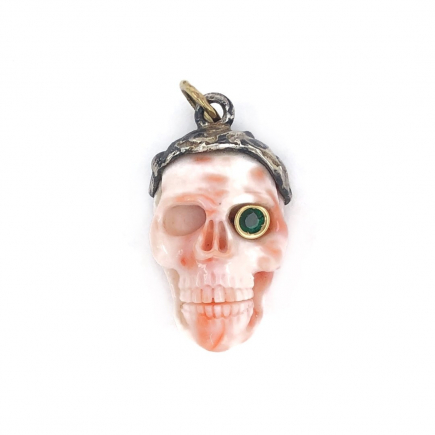 One-of-a-kind carved coral skull with emerald eye and silver and gold