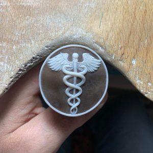 Handmade caduceus shell cameo