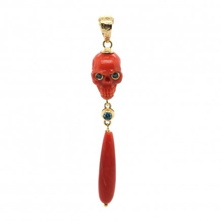 Carved red coral skull pendant with blue diamonds and 18kt gold