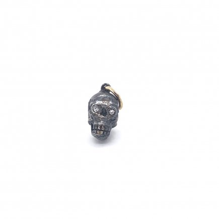 Skull Charm in silver and gold with diamond eyes
